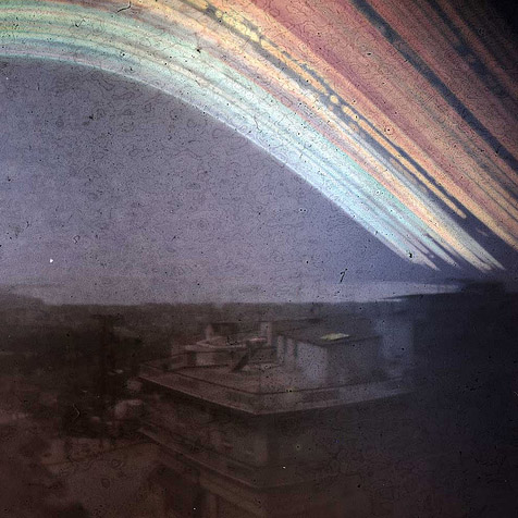 This is an example of Solargraphy. Solargraphy is the process of taking long exposures with pinhole cameras that last several MONTHS to record the light of the sun. This example was a 6 month exposure taken by solarigrafia on Flickr.