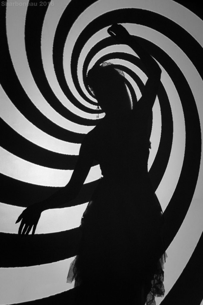 A spiral was being projected onto a wall/background creating a silhouette.